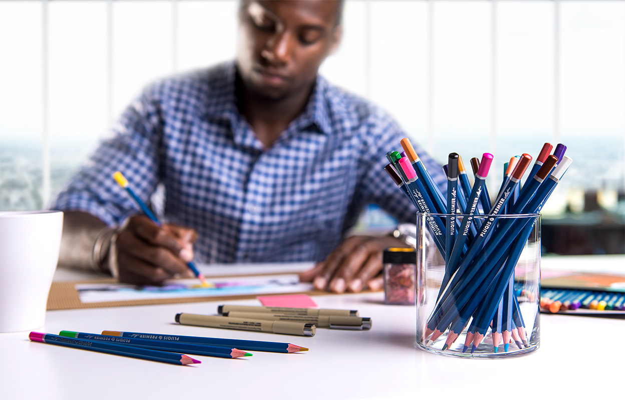 Lifestyle Photograph of Pluqis Color Pencils used by an Architect
